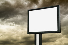 Billboard with empty screen over dark clouds Royalty Free Stock Image