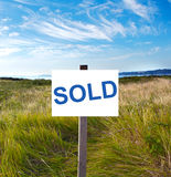 Billboard in the field. Blank billboard with message sold in the field royalty free stock photography