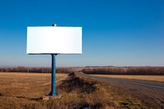Billboard in a field near the road Royalty Free Stock Image