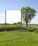 Billboard on green field Royalty Free Stock Photography