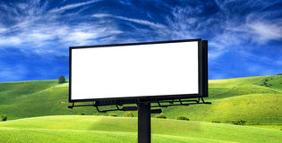 Billboard on green field Stock Images