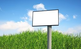 Billboard on a green grass Stock Photos