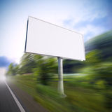 Billboard on the highway. Royalty Free Stock Image