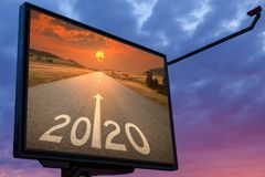 Advertisement for upcoming 2020 on billboard at sunset royalty free illustration