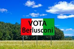 In the next elections save Italy, vote Berlusconi, Forza Italia. Billboard in the middle of a field under the blue sky says that in the upcoming elections the Stock Image
