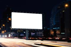 Billboard mockup outdoors. Outdoor advertising poster at night time with street light line for advertisement street city night. With clipping path on screen stock images