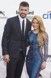 2014 Billboard Music Awards. LAS VEGAS - MAY 18 : Soccer player Gerard Pique (L) and recording artist Shakira attend the 2014 Billboard Music Awards at the MGM Royalty Free Stock Photo