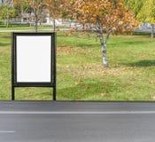 Billboard na jesieni miasta drodze z małym drzewem w jesieni Fotografia Royalty Free