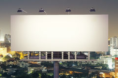 Billboard on night city background front Stock Image