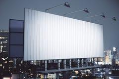 Billboard on night city background side Royalty Free Stock Image