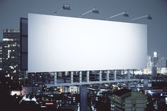 Billboard on night city background side Royalty Free Stock Photos