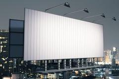 Billboard on night city background side Stock Photography