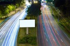 Billboard on a night street Royalty Free Stock Photos