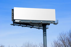 Billboard off highway. Blank big billboard over blue sky, put your own text here royalty free stock image