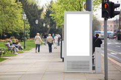 Billboard for outdoor advertising. On a city street. White screen, you can insert your picture here stock image