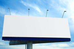 Billboard over blue sky. Blank big billboard over blue sky stock images