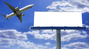 Billboard with plane. Big blank billboard with flying jet plane royalty free stock images