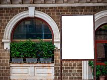 Billboard poster blank white against commerical office. Building royalty free stock photo