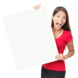 Billboard poster woman. Funny happy woman showing blank empty billboard poster sign. Isolated on white background stock photography