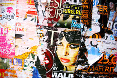 Billboard posters on wall ripped. Varna, Bulgaria - September 25, 2008: Fragment of a wall with set of billboard of discos. The season is ended, the rain and a Royalty Free Stock Photography