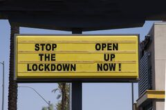 Free Billboard Saying Stop The Lockdown - Open Up Now! Anti-lockdown Protests Stock Photography - 183394122