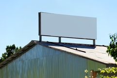 Billboard sign. A black billboard sign on top of a rural building Stock Photo