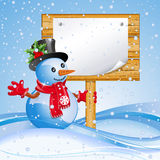 Billboard with snowman. Christmas blue background with snowman and billboard Royalty Free Stock Photo