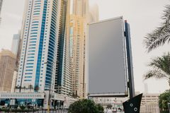 Billboard with space for text on the background of skyscrapers- Image stock images