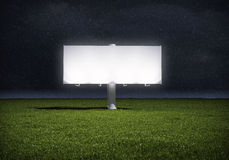 Billboard standing in a field of grass - night ver Royalty Free Stock Image