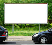Billboard in the street. Blank billboard in the street in spring stock photography