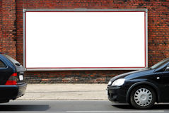 Billboard in the street. Billboard on an old brick wall in the street royalty free stock photos