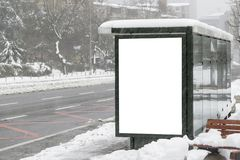 Billboard on street in winter royalty free stock photography