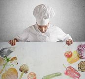Billboard of vegetable. Man chef shows his billboard of vegetable royalty free stock image