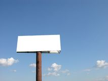 Billboard Waiting For Your Logo. Blank Billboard with Blue Skies stock image