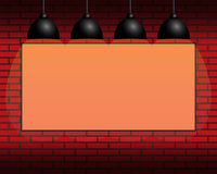 Billboard on the wall, orange background, illumination, backlight. Billboard with orange background on the wall, yellow illumination, backlight, lamps Royalty Free Stock Image