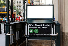 Billboard in Wall Street Station. Commercial sign in Wall Street subway station. Blank billboard with crowd and traffic in the background. Manhattan Financial royalty free stock photo