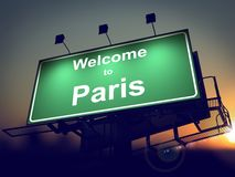 Billboard Welcome to Paris at Sunrise. Welcome to Paris - Green Billboard on the Rising Sun Background Stock Photo