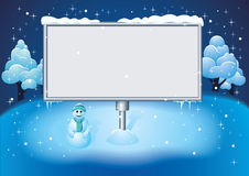 Billboard in winter night. Blank board on snow on winter background Royalty Free Stock Photography