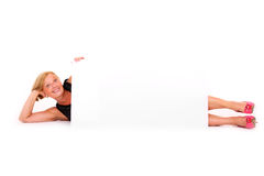 Billboard woman. A picture of an attractive mature woman lying with a banner over white background Royalty Free Stock Photos