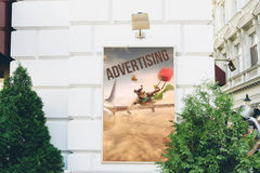 Billboards with advertising of conceptual travel. At city street Royalty Free Stock Images