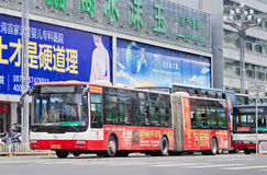 Billboards and bus with advertising, Kunming, China. KUNMING-JULY 5, 2014. Billboards and bus with an advert. China's outdoor advertising market has grown Stock Photography