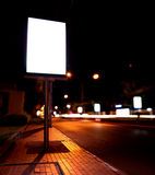 Billboards at bus stop in night. Blank of billboards at bus stop in night stock images