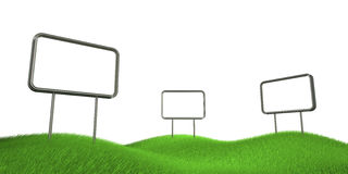 Billboards on grass hills Stock Photos