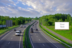 Billboards on the highway with lots of cars Royalty Free Stock Photo