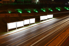 Billboards at night. Blank billboards next to a road in the night Stock Photo