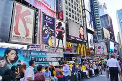 Billboards on Times Square in New York City. NEW YORK CITY -The busy Times Square at the intersection of Broadway and 7th Avenue in Manhattan with giant royalty free stock image