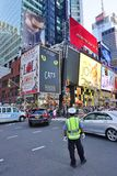 Billboards on Times Square in New York City. NEW YORK CITY -The busy Times Square at the intersection of Broadway and 7th Avenue in Manhattan with giant stock photo