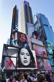 Billboards on Times Square in New York City. NEW YORK CITY -The busy Times Square at the intersection of Broadway and 7th Avenue in Manhattan with giant stock photos