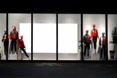 Billdoard del espacio en blanco de la ventana de la tienda del boutique de la moda foto de archivo libre de regalías