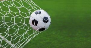 Bille de football dans le but Image stock